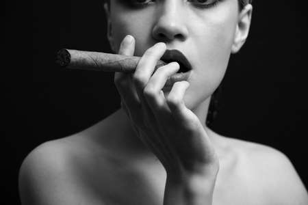 Portrait of elegant smoking woman. Fashion photo Stock Photo - 4342089