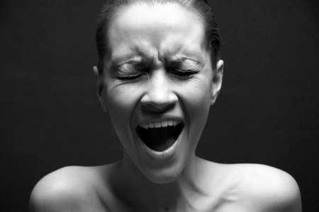 distressing: great pain. Portrait of loud girl. Studio portrait.