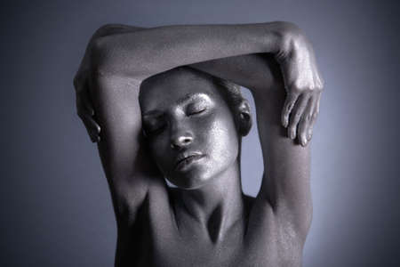 elegant body-art. woman with silver make-up. photo
