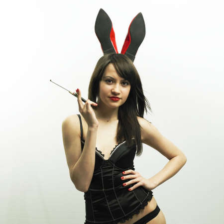 Studio photo of young seductive woman with rabbit ears photo