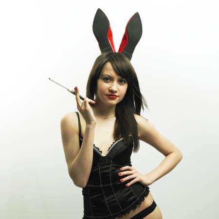 Studio photo of young seductive woman with rabbit ears photo