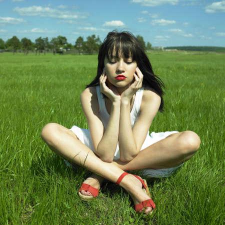 beautifu: Portrait of beautifu young woman on a green field Stock Photo