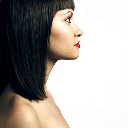 Fashion photo. Profile of woman with strict hairstyle photo