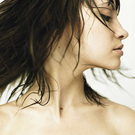 Fashion photo. Profile of woman with developing hair