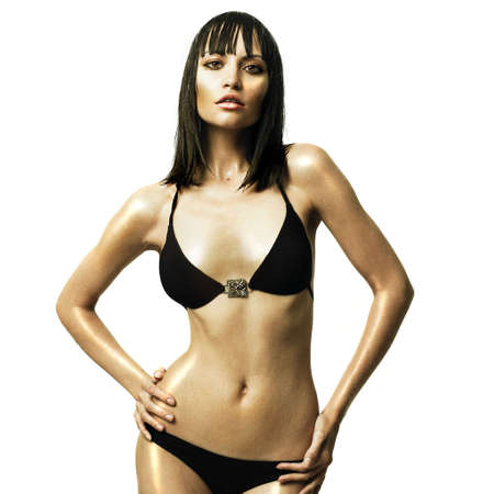 Fashion photo of young slender woman with wet hair photo