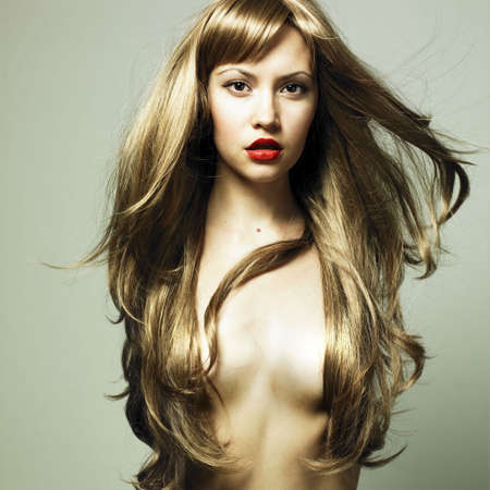 Fashion photo of beautiful woman with magnificent hair photo