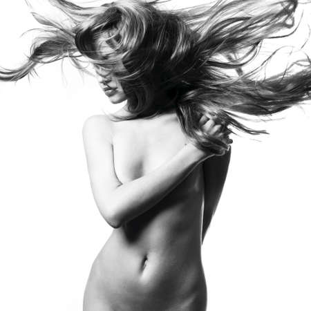Fashion photo of beautiful nude woman with magnificent hair Stock Photo