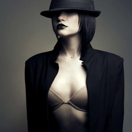 Portrait of beautiful stylish lady in hat. Studio fashion photo Stock Photo - 6115897