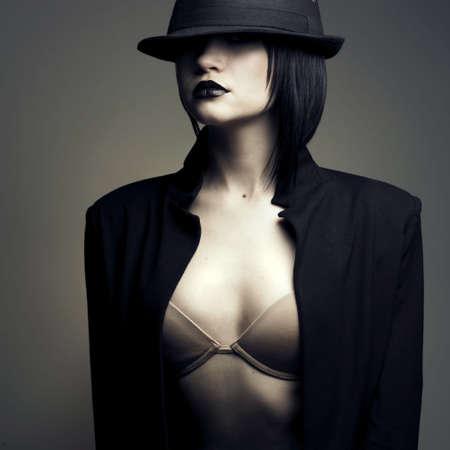 erotic: Portrait of beautiful stylish lady in hat. Studio fashion photo