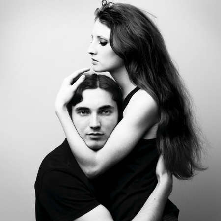 Fashion portrait of young beautiful lovers Stock Photo - 6614837