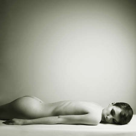 nude in bed: Nude elegant woman in bed. Art photo.