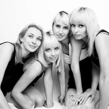 Studio photo of four young beautiful women photo