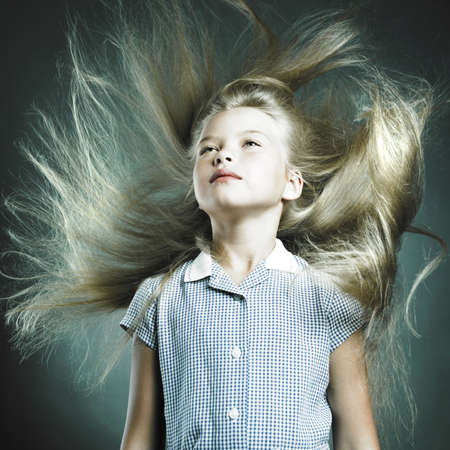 Portrait of little girl with magnificent hair photo