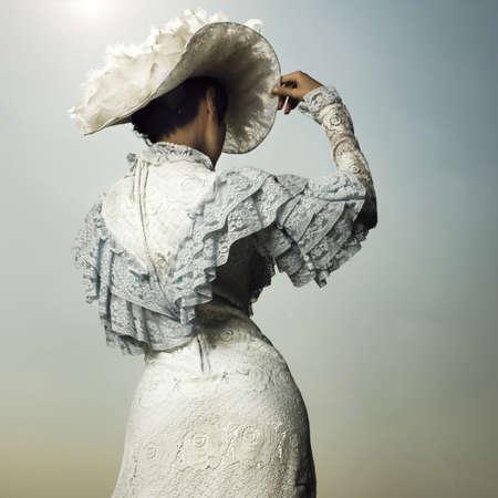nostalgic: Slender woman in vintage dress for promenade