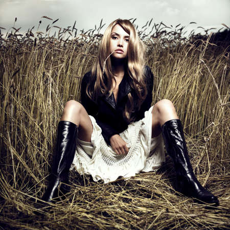 Portrait of sensual blond girl in wheat photo