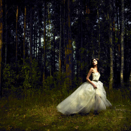 elegance fashion girls look sensuality young: Portrait of romantic woman in fairy forest Stock Photo