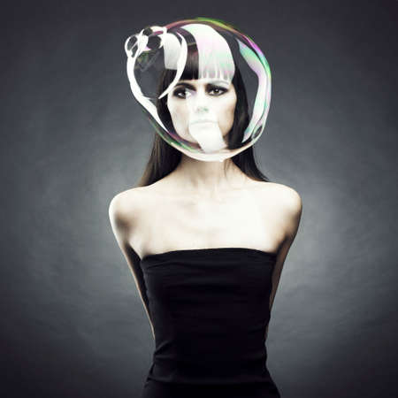 Beautiful woman with big soap bubble. Conceptual photo photo