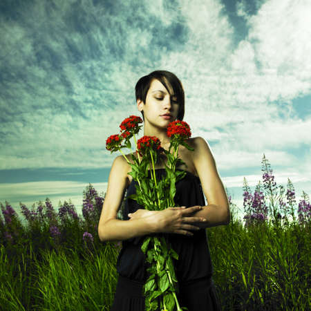 Portrait of romantic girl in flower meadow Stock Photo - 7706036