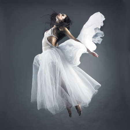 Picture a beautiful fairy flying girl in white dress Stock Photo - 7849854