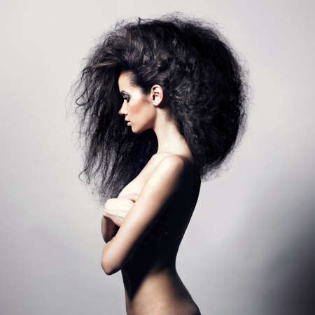Portrait of sensual woman with magnificent bushy hair Stock Photo