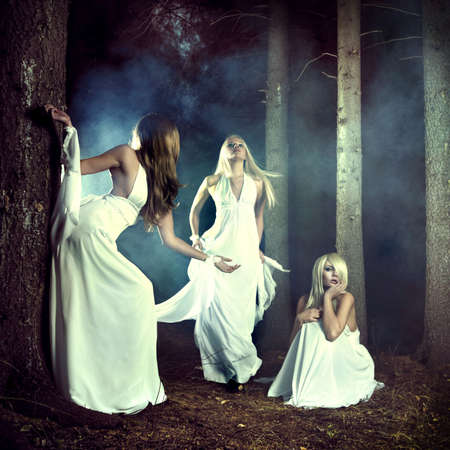 Portrait of three beautiful nymphs in misty forest Stock Photo - 8105843