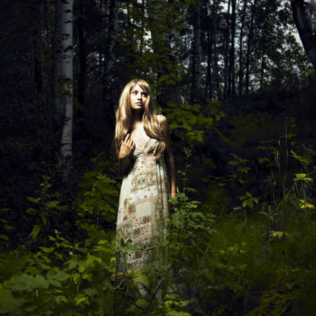 Portrait of romantic woman at fairy forest photo