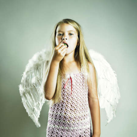 adorable: Portrait of a beautiful happy girl with angel wings