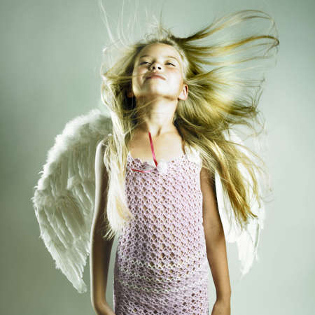 wings angel: Portrait of a beautiful happy girl with angel wings