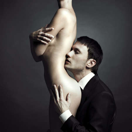 naked man: Portrait of young elegant couples in the tender passion