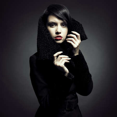 Portrait of a beautiful lady in an elegant coat photo