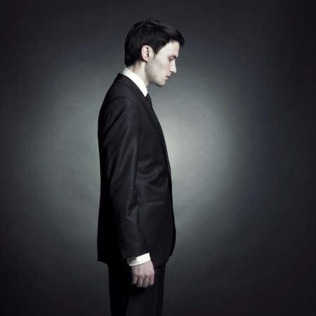 Portrait of handsome stylish man in elegant black suit Stock Photo - 8250030