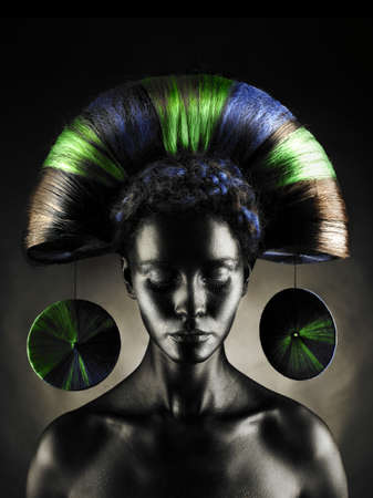 Portrait of a beautiful alien lady with an unusual hairstyle photo