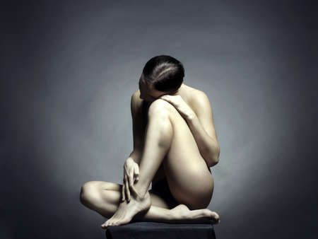 Nude beautiful sitting lady on black background  Stock Photo - 8682833