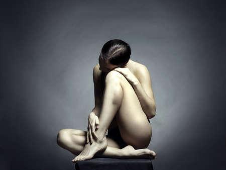 Nude beautiful sitting lady on black background  Stock Photo - 8682833
