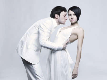 Portrait of young elegant couples in the tender passion photo