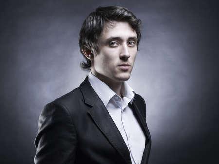 Portrait of handsome stylish man in elegant black suit Stock Photo - 8945566