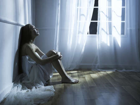 nightgown: Portrait of beautiful young girl in the interior of the window