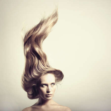 young beautiful woman with magnificent hair Stock Photo - 9361736