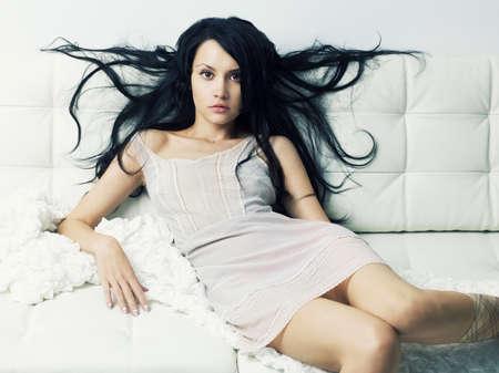 Photos of beautiful sensual woman sitting on a sofa Stock Photo - 9746193