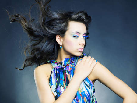 Photo of a young beautiful woman with bright makeup and manicure Stock Photo - 9746194
