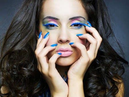 Photo of a young beautiful woman with bright makeup and manicure Stock Photo - 9746195