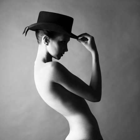 Black and white fashion portrait of naked lady with hat Stock Photo - 9744619