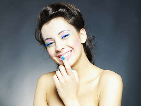 Beautiful smiling girl with bright makeup and manicure photo