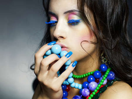 Fashion photo of young beautiful girl with bright beads Stock Photo - 9834019