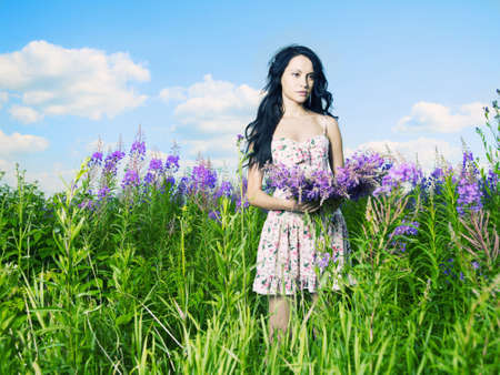 Portrait of a beautiful lady in a flower meadow Stock Photo - 10099272