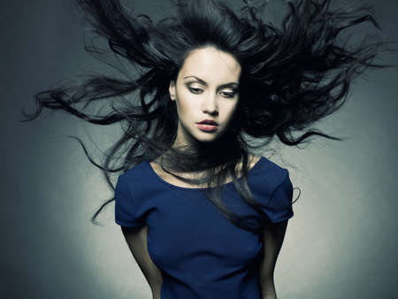 dark hair: Photo of young beautiful lady with magnificent dark hair Stock Photo