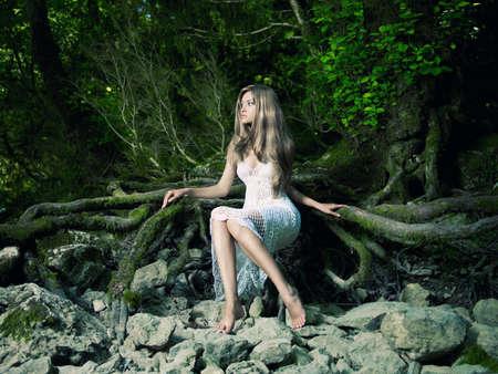 fairy tree: Portrait of beautiful elegant lady in a green rainforest