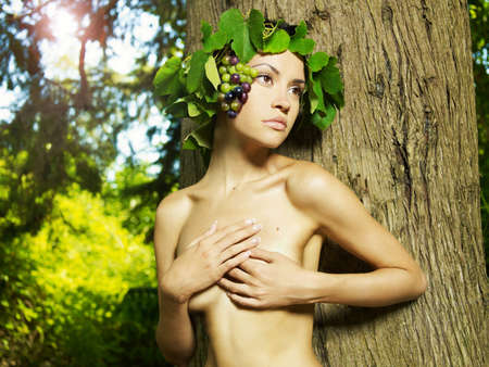 Portrait of an elegant lady naked in grape wreath  photo