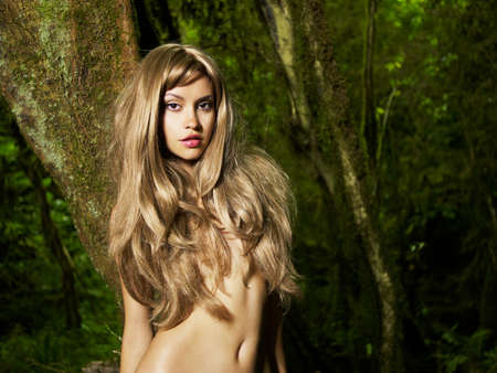 nymphs: Portrait of a nude elegant lady in a green rainforest