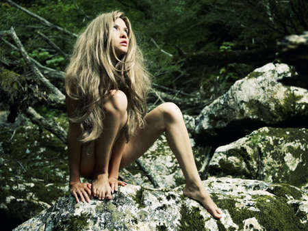 nude outdoors: Portrait of beautiful young savage in the jungle Stock Photo